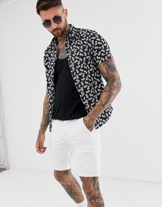 ASOS DESIGN skinny pineapple print shirt in black