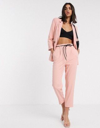 Stradivarius slouchy tailored pant with faux leather belt in pink