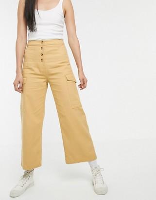Asos Design DESIGN wide leg lightweight jean with button detail in marigold-Yellow