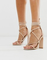 Truffle Collection toe loop heeled sandals with tie leg in beige