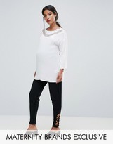Bluebelle Maternity Tapered Ankle Pants with Criss Cross Detail