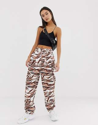 Asos Design DESIGN ovoid pleat front peg trouser in tiger print-Multi