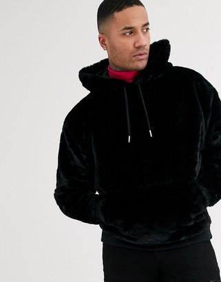 Asos Design DESIGN oversized faux fur hoodie in black