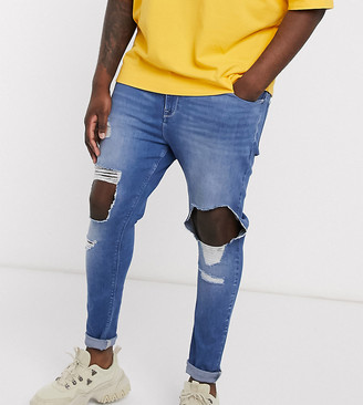 ASOS DESIGN Plus spray on jeans in power stretch with open rips in mid blue