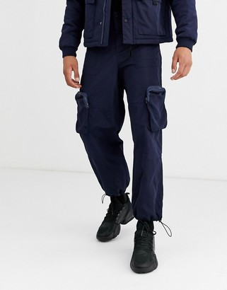 ASOS DESIGN co-ord cargo tech pants with 3D pockets in navy
