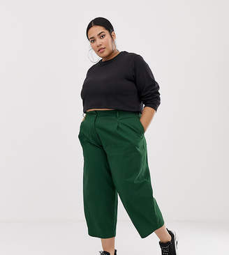 Asos DESIGN Curve balloon leg pants with lace up back in green