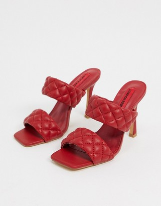 London Rebel quilted mules in dark red