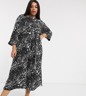 ASOS DESIGN Curve tie waist jumpsuit in black base animal print