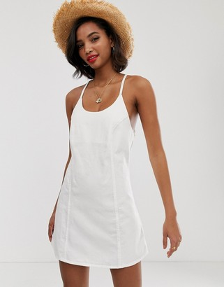 Asos Design DESIGN denim sundress with tie back in white