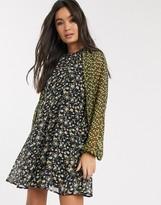 Asos Design DESIGN trapeze mini dress in mixed ditsy floral print