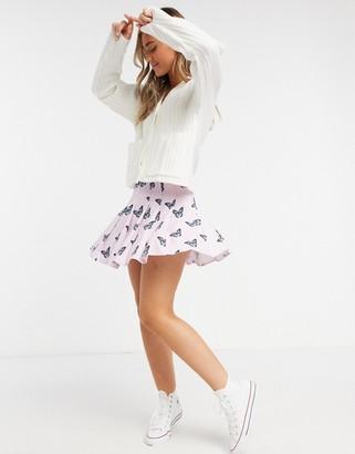 Skinnydip mini pleated skirt in butterfly print co-ord