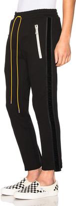 Rhude Pin Strip Pants in Black | FWRD