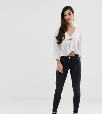 ASOS DESIGN petite whitby low rise skinny jeans in washed black with western fly detail