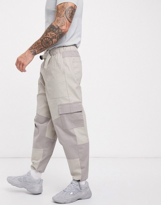 ASOS DESIGN tapered trousers in cut and sew colour blocking