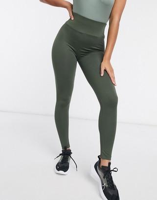 ASOS DESIGN leggings with deep waistband in khaki