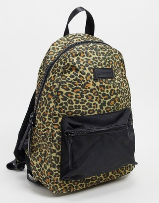 Consigned backpack with front pocket in leopard