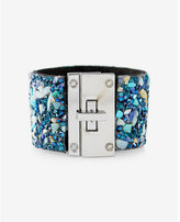 Express gem and stone encrusted turnlock cuff bracelet