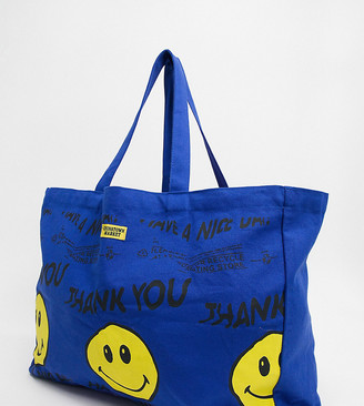 Chinatown Market Smiley Twisted tote bag in blue