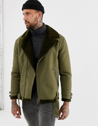Asos Design DESIGN faux shearling biker jacket with fleece lining in khaki-Green