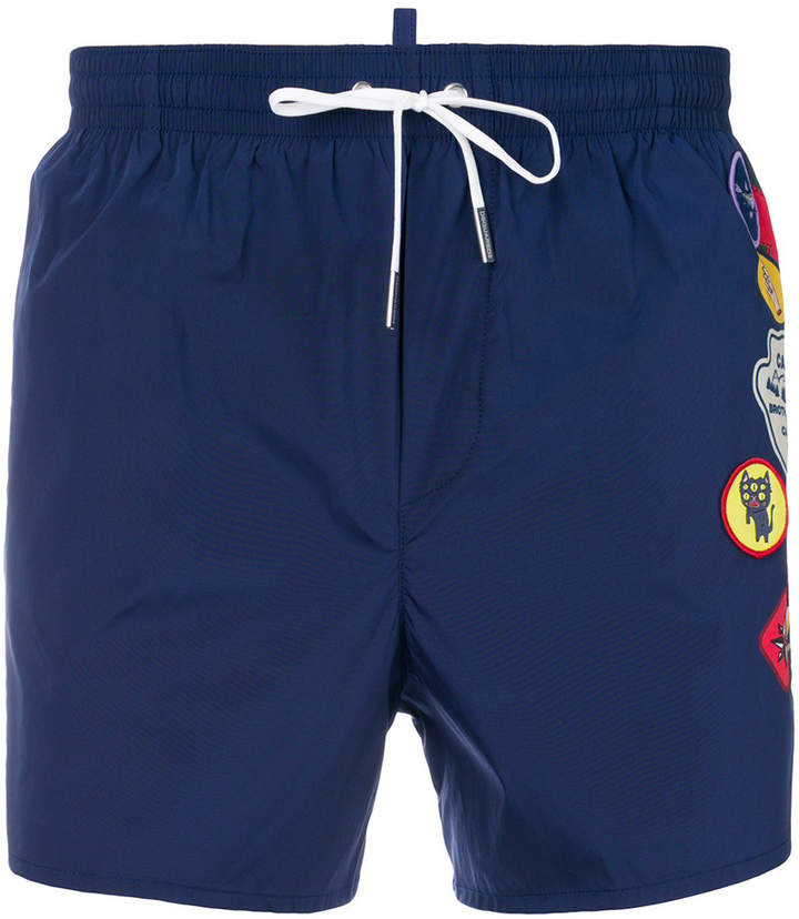 DSQUARED2 embellished patch swim shorts