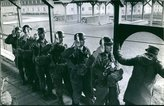 PickYourImage Vintage photo of 1960Soldiers lined up during training, holding rope carrying luggage.
