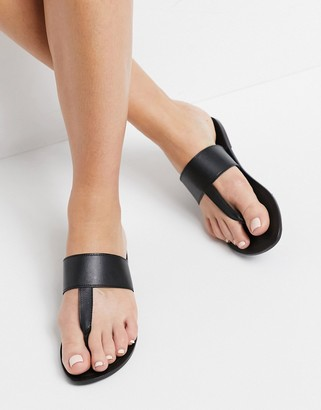 ASOS DESIGN Function leather toe thong sandals in black