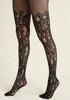 Your ensemble exudes an unexpected level of elegance, all thanks to your pink fishnet tights. Enveloping you in a dazzling floral motif, scrolling vines, and sumptuous scallops set flirtatiously at each garter line, this eye-catching hosiery makes for a b