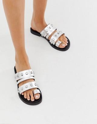 ASOS DESIGN Freewheel premium leather studded toe loop sandals in silver