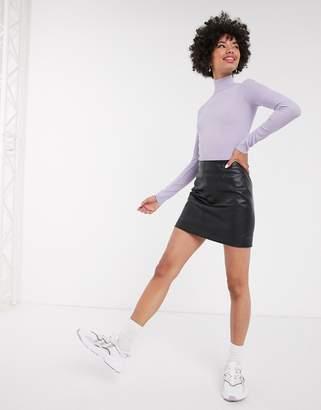 Monki mini leather look skirt in black