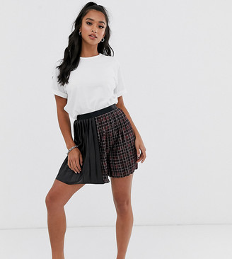 Asos DESIGN Petite leather look and check pleated mini skirt
