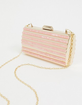 True Decadence gold and resin structured clutch bag with detachable strap