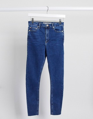 ASOS DESIGN high rise ridley 'skinny' jeans in bright midwash blue with raw hem