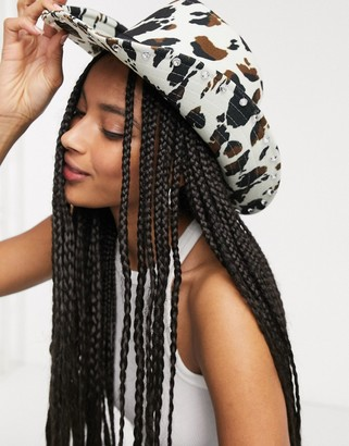 Asos DESIGN cowboy hat with diamantes and size adjuster in cow print