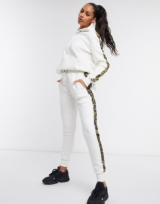 Criminal Damage leopard stripe joggers tracksuit in white