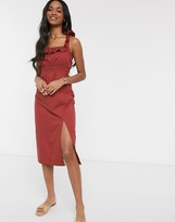 Asos Design DESIGN cotton midi sundress with shirred waist and lace up back in rust