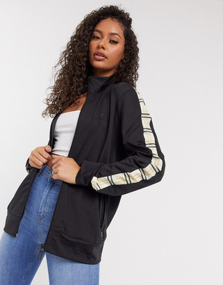 Criminal Damage zip through track top in black