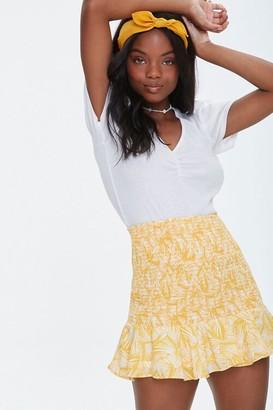 Forever 21 Tropical Print Smocked Mini Skirt
