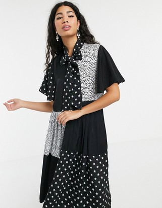 Sister Jane pleated midi dress with pussybow in animal star mixed print-Black