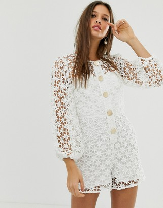 ASOS DESIGN premium floral lace romper with gold button detail and cut out back