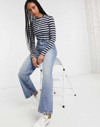 Monki Samina organic cotton long sleeve stripe top in blue and white