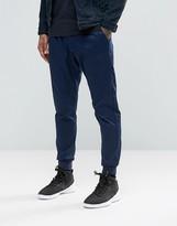 Nike Modern Woven Slim Joggers In Blue 805098-451