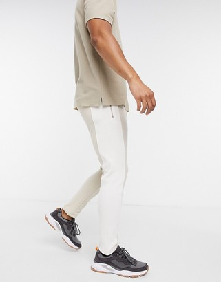 The Couture Club rib panelled tapered track pants in beige