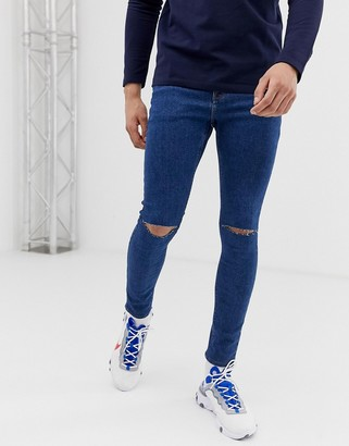 ASOS DESIGN spray on jeans in power stretch open end blue with knee rips
