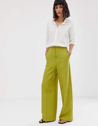 Asos Design DESIGN clean high waist wide leg pants with pocket detail-Green