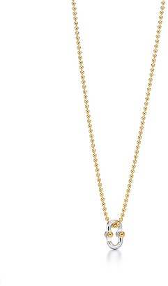 "Tiffany & Co. 1837TM Makers clip pendant in 18k gold and sterling silver, 24""."
