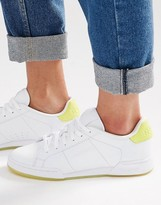 Reebok NPC II Sneakers With Yellow Heel And Sole Detail