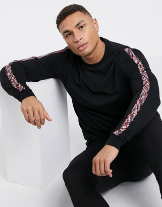 ASOS DESIGN long sleeve t-shirt with woven Geo-Tribal tape