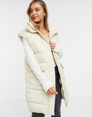 Monki Lumi recycled sleeveless padded gilet in beige