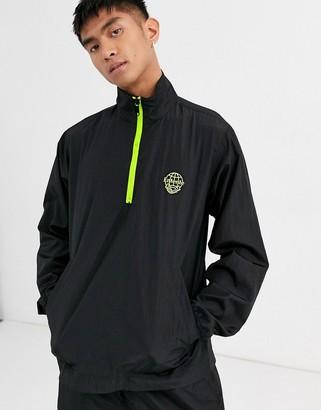 Entente nylon jacket in black with neon half zip