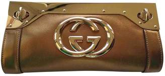 Gucci Gold Leather Clutch bags